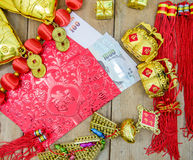 Thai money in red envelope with golden stuff for chinese new yea Stock Photography