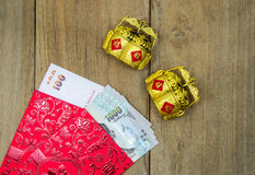 Thai money  red envelope with golden stuff for chinese new yea Stock Image