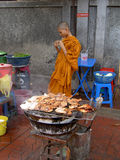 Thai monk behind a grill, Bangkok, Thailand. Stock Images