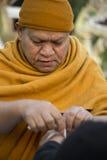 Thai Monk blessing Royalty Free Stock Photos