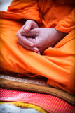 Thai monk. Closeup of a monk's hands as he meditates - Thailand travel and tourism Stock Photography