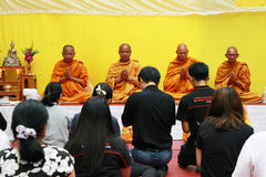 Thai monk Prayer and blessing to the people. Royalty Free Stock Photography