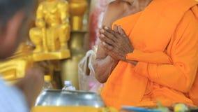 Thai monk praying in temple stock footage
