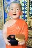 Thai monk  statue. Thai monk statue smiling in thai temple Stock Image
