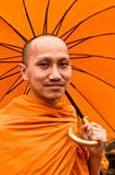 Thai Monk With Umbrella. A Buddhist monk with umbrella in Chiang-Mai, Thailand Royalty Free Stock Photo