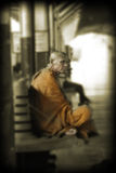 A Thai Monk waits for his train at the old train station in Bangkok Royalty Free Stock Photo
