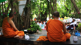 Thai monks wait people to offer foods Stock Image