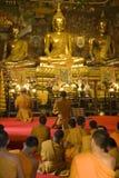 Thai Monks Worshipping. Monks worshipping at Wat Phanan Choeng in Ayutthaya near Bangkok, Thailand stock photo