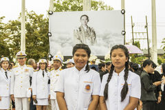 Thai mourners take picture after Mourning Ceremony of King Stock Image