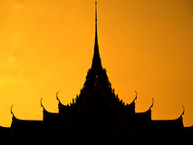 Thai multiple roof tiers. In silhouette style Stock Photos