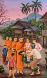 Thai mural painting of the offering food to Buddhist monks at Wa Stock Photo
