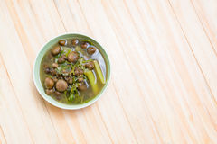 Thai mushroom soup with tamarind leaves. Royalty Free Stock Photo