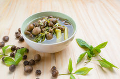 Thai mushroom soup with tamarind leaves. Stock Image
