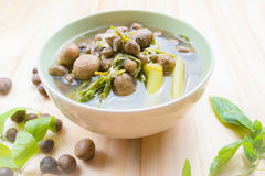 Thai mushroom soup with tamarind leaves. Stock Images