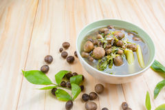 Thai mushroom soup with tamarind leaves. Stock Photos