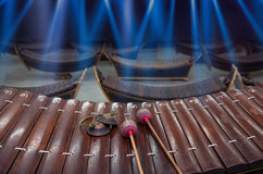Thai musical instrument (Alto xylophone) with note in thai character. On blue luminous rays background,asian instrument Stock Images
