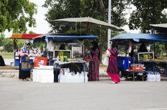 Thai muslim people sale and buy product and food at local restaurant thai style at beside road near public park. On July 13, 2016 in Yala, Thailand stock photo