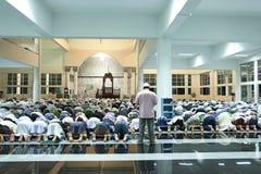 Thai Muslims mass prayers. Krabi, Thailand - February 8, 2011: Muslim devotees mass prayer at Krabi Central Mosque in Krabi, Thailand Stock Photo