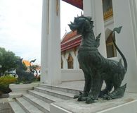 Thai Mythical creature Bronz singha ruplica  guarding the  Marble temple entrance Royalty Free Stock Photography