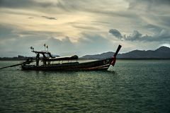 Thai national boat sailing around the bay stock photography