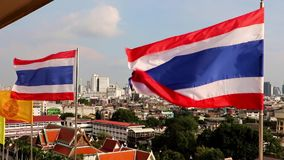Thai National flag on the top over Bangkok stock video footage