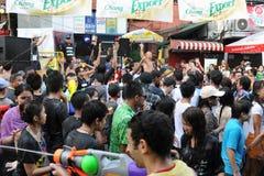 Thai New Year Celebrations in Bangkok. Revellers enjoy Thai new year celebrations on Khao San Road on April 13, 2012 in Bangkok, Thailand. The new year, or stock image
