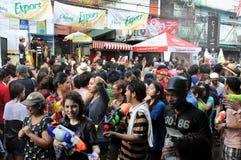 Thai New Year Celebrations in Bangkok. Revellers enjoy Thai new year celebrations on Khao San Road on April 13, 2012 in Bangkok, Thailand. The new year, or stock photography