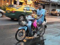Thai New Year Revellers. Revellers on a motorbike celebrate Songkran, the Thai new year,  on April 13, 2012 in Bangkok, Thailand. Traditionally the new year is Royalty Free Stock Photo
