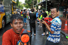Thai New Year Revellers Enjoy a Water Fight. Revellers participate in a water fight in celebrating the Thai new year on April 13, 2012 in Bangkok, Thailand. The royalty free stock photo