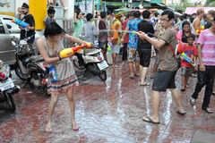 Thai New Year Revellers Enjoy a Water Fight. Revellers participate in a water fight in celebrating the Thai new year on April 13, 2012 in Bangkok, Thailand. The royalty free stock image