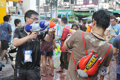 Thai New Year Revellers Enjoy a Water Fight. Revellers participate in a water fight in celebrating the Thai new year on April 13, 2012 in Bangkok, Thailand. The stock image