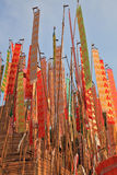 Thai New Year - Songkran. Colorful multicolored flags and pennants adorn a special bamboo tower Royalty Free Stock Image