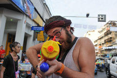 Thai New Year - Songkran. A reveller aims a water-gun while celebrating the Thai New Year near Khao San Road on April 12, 2013 in Bangkok, Thailand. The Thai New royalty free stock photography