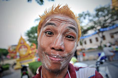 Thai New Year - Songkran. A reveller celebrates the Thai New Year near Khao San Road on April 12, 2013 in Bangkok, Thailand. The Thai New Year, or Songkran, is royalty free stock image