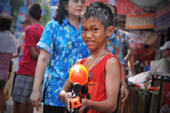 Thai New Year - Songkran. A reveller poses with a water-gun while  celebrating the Thai New Year near Khao San Road on April 12, 2013 in Bangkok, Thailand. The Royalty Free Stock Photos