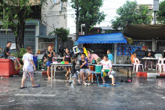 Thai New Year - Songkran. Revellers celebrate the Thai New Year on a city street on April 13, 2013 in Bangkok, Thailand. The Thai New Year, or Songkran, is Stock Image