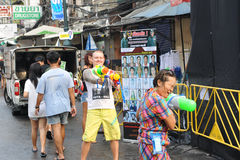 Thai New Year - Songkran. Revellers celebrate the Thai New Year on Khao San Road on April 12, 2013 in Bangkok, Thailand. The Thai New Year, or Songkran, is royalty free stock image