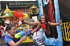 Thai New Year - Songkran. Revellers celebrate the Thai New Year on Khao San Road on April 12, 2013 in Bangkok, Thailand. The Thai New Year, or Songkran, is stock photos
