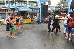 Thai New Year - Songkran. Revellers celebrate the Thai New Year on Khao San Road on April 12, 2013 in Bangkok, Thailand. The Thai New Year, or Songkran, is Stock Photography