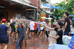 Thai New Year - Songkran. Revellers celebrate the Thai New Year near Khao San Road on April 12, 2013 in Bangkok, Thailand. The Thai New Year, or Songkran, is stock photos