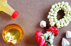 Thai new year Songkran water festival greeting with jasmine garland perfume in bowl and soft-prepared chalk for copy space and bac Royalty Free Stock Image