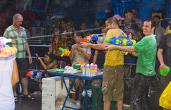 Thai new year - water festival. BANGKOK - APRIL 13 2009: Songkran (thai new year / water festival) is celebrated from april 13 to 15. people roam the streets and Stock Photos