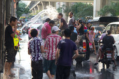 Thai new year water fight. BANGKOK - April 15: Songkran Festival is celebrated in Thailand as the traditional New Year's Day from 13 to 15 April by throwing Royalty Free Stock Image
