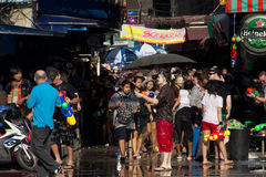 Thai new year water fight. BANGKOK - April 15: Songkran Festival is celebrated in Thailand as the traditional New Year's Day from 13 to 15 April by throwing Royalty Free Stock Photo