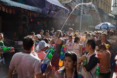 Thai new year water fight. BANGKOK - April 15: Songkran Festival is celebrated in Thailand as the traditional New Year's Day from 13 to 15 April by throwing Royalty Free Stock Images