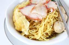 Thai noodle. Thai dry noodles with roast red pork and chopsticks royalty free stock photography
