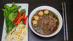 Thai noodle with beef and meatballs. Thai noodle in black soup Royalty Free Stock Photo