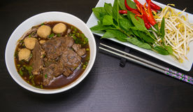 Thai noodle with beef and meatballs. Thai noodle in black soup Stock Image