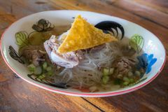 Thai noodle clear soup with spare rid and crispy dumpling. stock photos