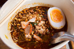 Thai noodle with egg. Thai spicy noodle with egg in bowl Royalty Free Stock Photo
